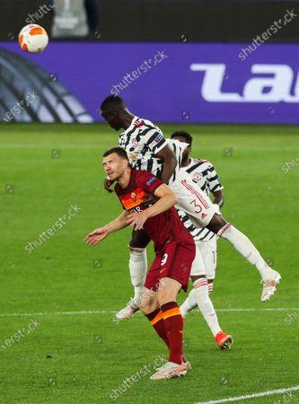 Eric Bailly of Manchester United and Edin Dzeko of Roma