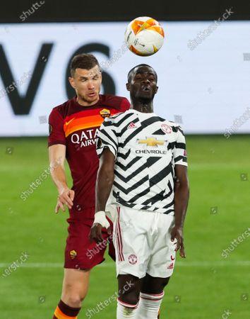 Stock Photo of Edin Dzeko of Roma and Eric Bailly of Manchester United