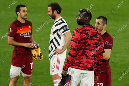 Paul Pogba of Manchester United and Henrikh Mkhitaryan of Roma at the end of the game