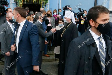 Secretary of State Antony Blinken, centre left, gestures with a Head of the Independent Ukrainian Church Metropolitan Epiphanius as they visit the Mikhailovsky Zlatoverkhy Cathedral (St. Michael's Golden-Domed Cathedral) in Kyiv, Ukraine, . Blinken is in Kyiv on Thursday, meeting top Ukrainian officials during a one-day visit that is highly anticipated in the country as it faces heightened tensions with Russia