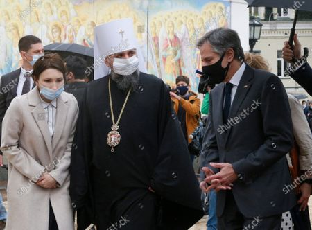 Secretary of State Antony Blinken, right, accompanied by the Head of the Independent Ukrainian Church Metropolitan Epiphanius, left, visit the Mikhailovsky Zlatoverkhy Cathedral (St. Michael's Golden-Domed Cathedral) in Kyiv, Ukraine, . Blinken is in Kyiv on Thursday, meeting top Ukrainian officials during a one-day visit that is highly anticipated in the country as it faces heightened tensions with Russia