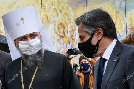 Secretary of State Antony Blinken, right, accompanied by the Head of the Independent Ukrainian Church Metropolitan Epiphanius, visits the Mikhailovsky Zlatoverkhy Cathedral (St. Michael's Golden-Domed Cathedral) in Kyiv, Ukraine