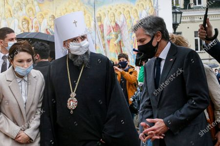 Secretary of State Antony Blinken, right, accompanied by the Head of the Independent Ukrainian Church Metropolitan Epiphanius, second left, visits the Mikhailovsky Zlatoverkhy Cathedral (St. Michael's Golden-Domed Cathedral) in Kyiv, Ukraine