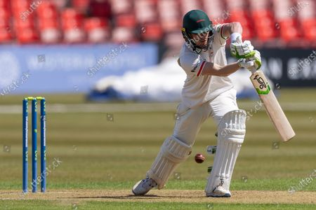 Sam Evans drives for 4 during Day 1 of the LV= Insurance County Championship match between Leicestershire County Cricket Club and Surrey County Cricket Club at the Uptonsteel County Ground, Leicester