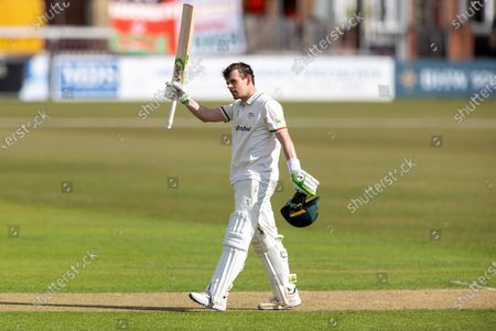 100 - Sam Evans acknowledges his team mates on reaching 100 during Day 1 of the LV= Insurance County Championship match between Leicestershire County Cricket Club and Surrey County Cricket Club at the Uptonsteel County Ground, Leicester