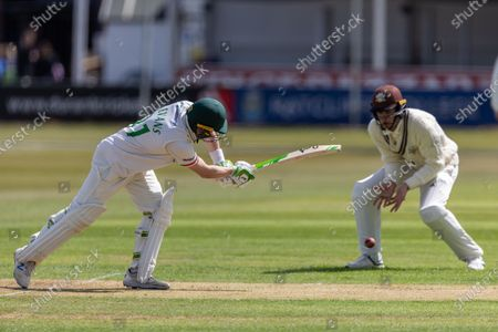 Sam Evans drives past short leg during Day 1 of the LV= Insurance County Championship match between Leicestershire County Cricket Club and Surrey County Cricket Club at the Uptonsteel County Ground, Leicester