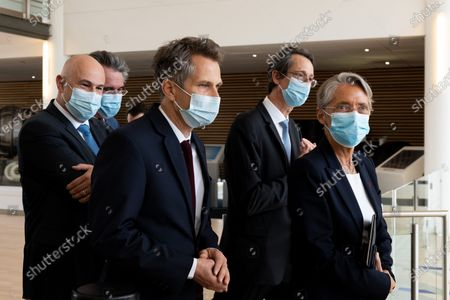 Safran CEO Olivier Andries and Safran DRH Stephane Dubois, Elisabeth Borne and Laurent Pietraszewski.  The Minister of Labor, Employment and Insertion, visiting the Safran Group Headquarters Medical Center for the Covid Vaccination Campaign 19.French labor minister visiting the company Safran's vaccination center on May 5, 2021 in Magny les Hameaux. The company is one of the first to deploy a vaccination center in France inside their buildings.