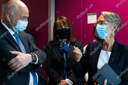 Stock Picture of Elisabeth Borne and Laurent Pietraszewski. The Minister of Labor, Employment and Integration, visiting the Safran Group Headquarters Medical Center for the Covid Vaccination Campaign 19.French labor minister visiting the company Safran's vaccination center on May 5, 2021 in Magny les Hameaux. The company is one of the first to deploy a vaccination center in France inside their buildings.