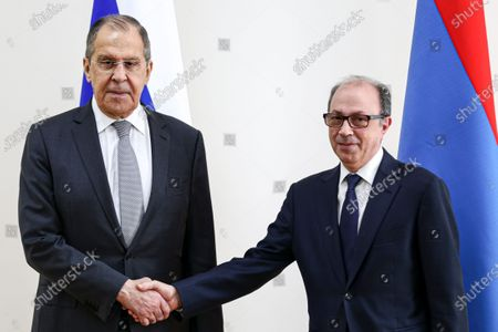 In this handout photo released by Russian Foreign Ministry Press Service, Russian Foreign Minister Sergey Lavrov, left, and Armenian Foreign Minister Ara Aivazian pose for a photo prior to their talks in Yerevan, Armenia