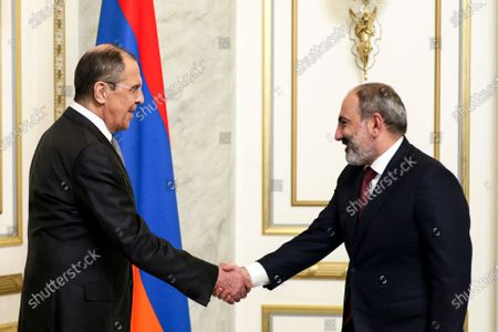 In this photo released by Russian Foreign Ministry Press Service, Russian Foreign Minister Sergey Lavrov, left, and Armenian acting Prime Minister Nikol Pashinyan greet each other prior to their talks in Yerevan, Armenia