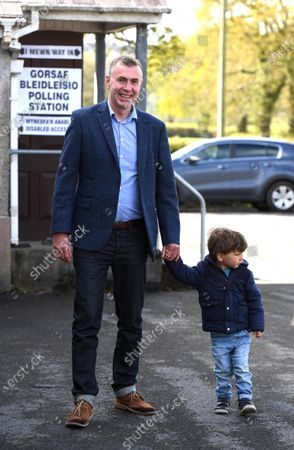Plaid Cymru leader Adam Price after voting in the Senedd election with his son at his local polling station Pontargothi Memorial Hall, Pontargothi, Carmarthen.