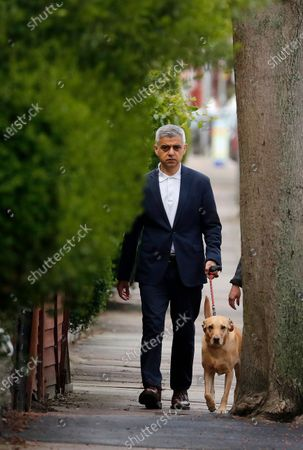 Mayor of London Sadiq Khan and his dog Luna arrive at the polling station at St Albans Church in London, . Millions of people across Britain will cast a ballot on Thursday, in local elections, the biggest set of votes since the 2019 general election. A Westminster special-election is also taking place in Hartlepool, England