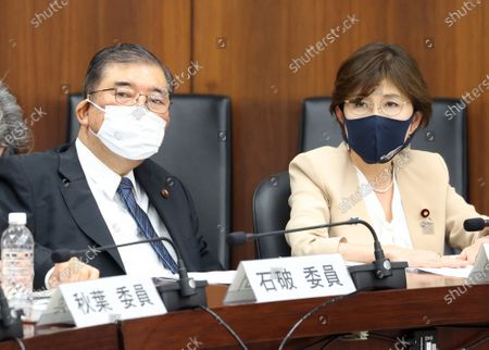 Japan's ruling Liberal Democratic Party lawmakers Shigeru Ishiba (L) and Tomomi Inada (R) attend a session of Lower House's commission of the Constitution at the National Diet in Tokyo on Thursday, May 6, 2021. Lower House's commission of the Constitution approved a bill to amendthe national referendum on revision of the Constitution at the session.