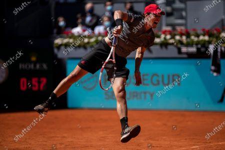Australia's Alex de Minaur serves to Dominic Thiem of Austria during their match at the Mutua Madrid Open tennis tournament in Madrid, Spain