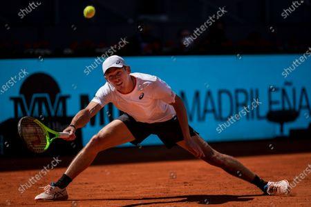 Dominic Thiem of Austria returns the ball to Australia's Alex de Minaur during their match at the Mutua Madrid Open tennis tournament in Madrid, Spain