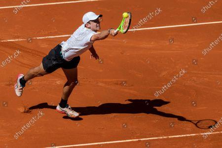 Dominic Thiem of Austria fails to return the ball to Australia's Alex de Minaur during their match at the Mutua Madrid Open tennis tournament in Madrid, Spain