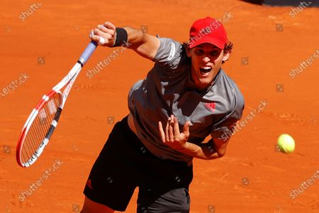 Dominic Thiem of Austria in action against Alex de Minaur of Australia during their Mutua Madrid Open round of 16 match at the Mutua Madrid Open tennis tournament in Madrid, Spain, 05 May 2021.