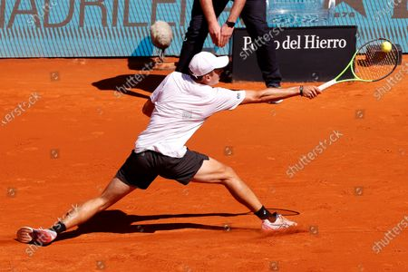 Stock Photo of Alex de Minaur of Australia in action against Dominic Thiem of Austria during their Mutua Madrid Open round of 16 match at the Mutua Madrid Open tennis tournament in Madrid, Spain, 05 May 2021.