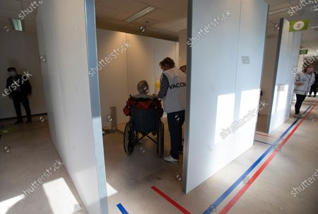 Man inside of a cubicle receives the Johnson & Johnson COVID-19 vaccination at a social center in Antwerp, Belgium, . Antwerp has opened several satellite vaccination centers in areas of the city where people have less ability or means to make it to the larger centers