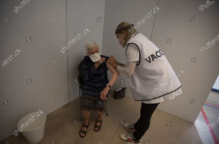 Woman receives the Johnson & Johnson COVID-19 vaccination at a social center in Antwerp, Belgium, . Antwerp has opened several satellite vaccination centers in areas of the city where people have less ability or means to make it to the larger centers
