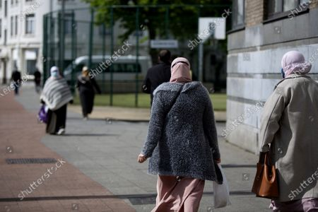 Women walk with protective face masks in Antwerp, Belgium, . Antwerp is continuing its vaccination drive to get as many of its citizens vaccinated by summer as COVID-19 restrictions stay in place in Belgium