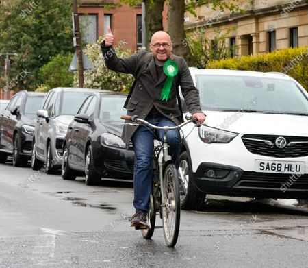 Scottish Green Party Co-leader Patrick Harvie arrives on his bicycle to cast his vote at the polling station at Notre Dame Primary School in the west end of Glasgow today.