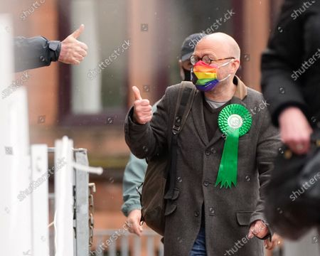 Scottish Green Party Co-leader Patrick Harvie gets a thumbs up from a member of the electorate after casting his vote at the polling station at Notre Dame Primary School in the west end of Glasgow today.