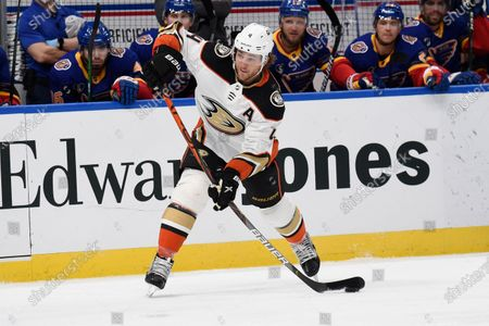 Anaheim Ducks' Cam Fowler (4) takes a shot against the St. Louis Blues during the first period of an NHL hockey game, in St. Louis