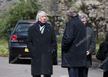 JPR Williams chats with Derek Quinnell at the funeral of former Wales and British Lions captain and coach John Dawes at Llandaff Cathedral, Cardiff