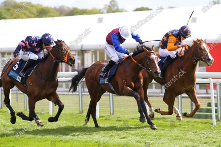 Mercurial and Hayley Turner [centre] wins the British Stallion Studs EBF Maiden Stakes at Chester from Russellinthebushes [right] and Zoltan Star [left].