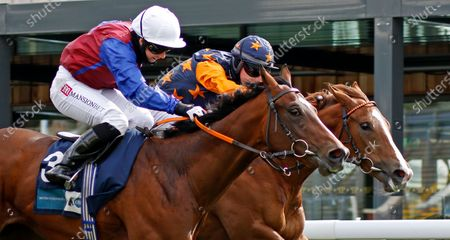Stock Picture of MERCURIAL (nearside, Hayley Turner) beats RUSSELLINTHEBUSHES (farside) in The British Stallion Studs EBF Maiden Stakes Chester