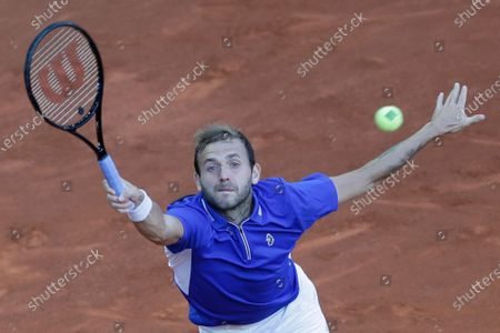 Daniel Evans of Britain returns the ball to Alexander Zverev of Germany during their match at the Madrid Open tennis tournament in Madrid, Spain