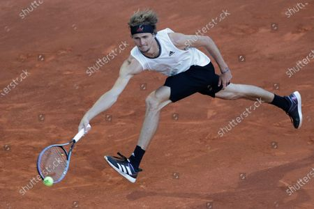 Alexander Zverev of Germany returns the ball to Daniel Evans of Britain during their match at the Madrid Open tennis tournament in Madrid, Spain