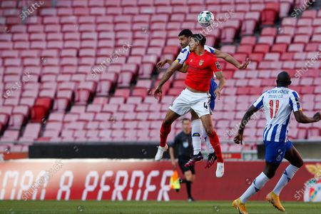 Lucas Verissimo and Mehdi Taremi dispute the ball during the Liga NOS match between Benfica and FC Porto at Estadio da Luz, Benfica