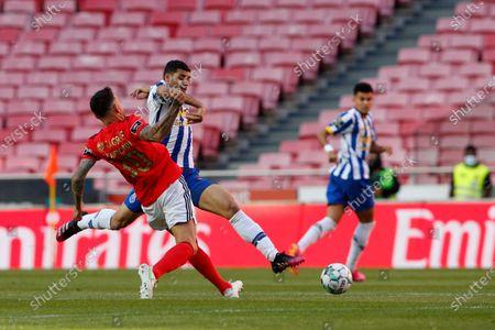 Nicolás Otamendi and Mehdi Taremi disputing the ball during the Liga NOS match between Benfica and FC Porto at Estadio da Luz, Benfica