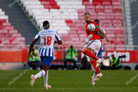Chancel Mbemba reaching the ball in front of Haris Seferovic during the Liga NOS match between Benfica and FC Porto at Estadio da Luz, Benfica
