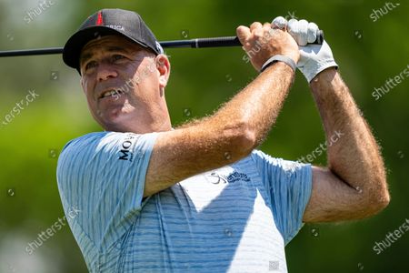 Stewart Cink watches his tee shot on the third hole during the first round of the Wells Fargo Championship golf tournament at Quail Hollow Club, in Charlotte, N.C