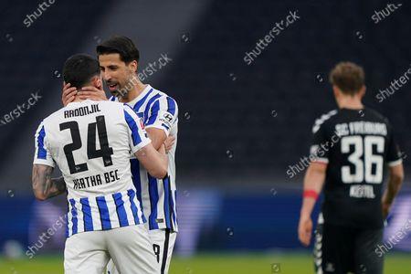 Berlin's Nemanja Radonjic, front left, celebrates after scoring his side's third goal during the German Bundesliga soccer match between Hertha BSC Berlin and SC Freiburg in Berlin, Germany
