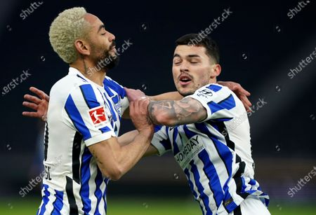 Berlin's Nemanja Radonjic, right, celebrates with Berlin's Matheus Cunha after scoring his side's third goal during the German Bundesliga soccer match between Hertha BSC Berlin and SC Freiburg in Berlin, Germany