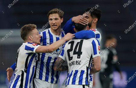 Berlin's Nemanja Radonjic celebrates with teammates after scoring his side's third goal during the German Bundesliga soccer match between Hertha BSC Berlin and SC Freiburg in Berlin, Germany