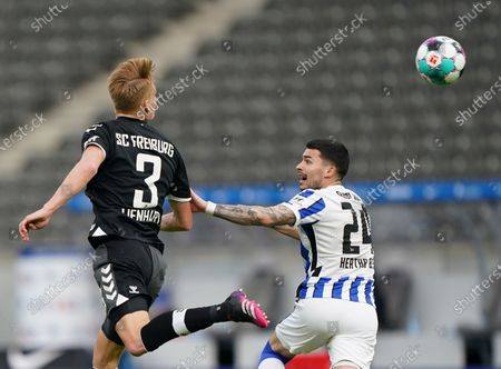 Freiburg's Philipp Lienhart, left, duels for the ball with Berlin's Nemanja Radonjic during the German Bundesliga soccer match between Hertha BSC Berlin and SC Freiburg in Berlin, Germany