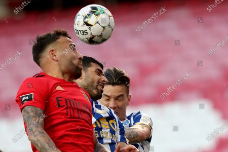 Otamendi of SL Benfica (L) vies with Mehdi Taremi of FC Porto (C ) and Matheus Uribe (R ) during the Portuguese League football match between SL Benfica and FC Porto at the Luz stadium in Lisbon, Portugal on May 6, 2021.