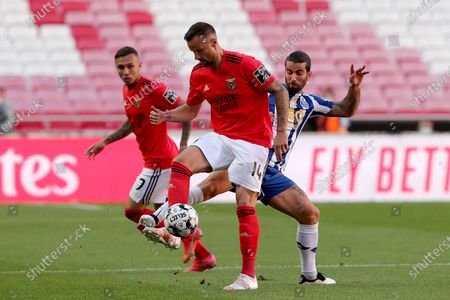 Stock Photo of Haris Seferovic of SL Benfica (C ) vies with Sergio Oliveira of FC Porto (R ) during the Portuguese League football match between SL Benfica and FC Porto at the Luz stadium in Lisbon, Portugal on May 6, 2021.