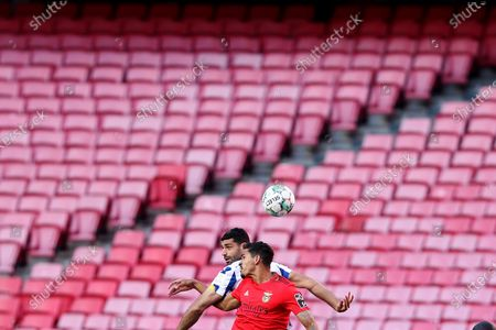 Mehdi Taremi of FC Porto (L) vies with Lucas Verissimo of SL Benfica during the Portuguese League football match between SL Benfica and FC Porto at the Luz stadium in Lisbon, Portugal on May 6, 2021.