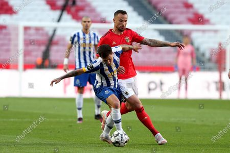 Otavio of FC Porto (L) vies with Haris Seferovic of SL Benfica during the Portuguese League football match between SL Benfica and FC Porto at the Luz stadium in Lisbon, Portugal on May 6, 2021.