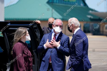Stock Picture of Louisiana Gov. John Bel Edwards, center, and his daughter Sarah Ellen talk with President Joe Biden as he arrives at Chennault International Airport, in Lake Charles, La