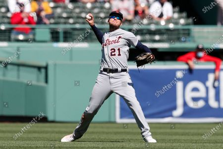 Detroit Tigers' JaCoby Jones fields the ball on the single by Boston Red Sox's Xander Bogaerts during the fourth inning of a baseball game, in Boston