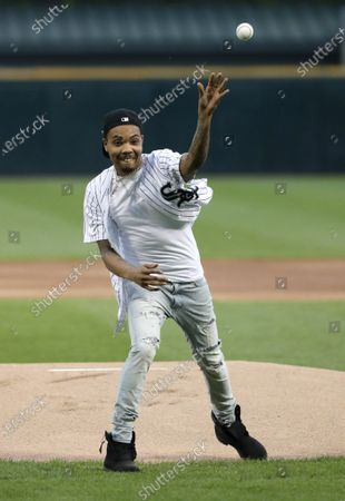 Chicago rapper G Herbo throws a ceremonial first pitch before a baseball game between the Chicago White Sox and the Washington Nationals in Chicago. Federal prosecutors announced that the Chicago native, whose real name is Herbert Wright III, was charged with lying to federal investigators. In December, the 25-year-old G Herbo was among six people, including his promoter, indicted for conspiracy to commit wire fraud and aggravated identity theft