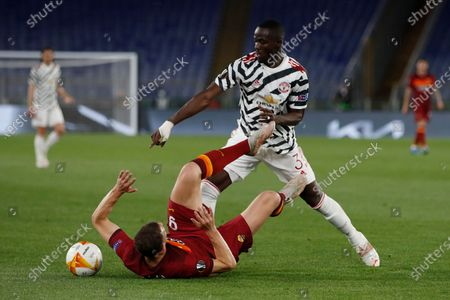 Roma's Edin Dzeko, bottom, is challenged by Manchester United's Eric Bailly during the Europa League semifinal, second leg soccer match between Roma and Manchester United at Rome's Olympic stadium, Italy