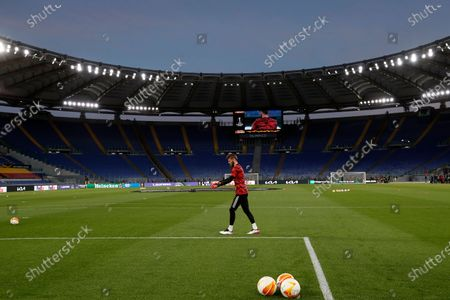 Manchester United's goalkeeper David de Gea warms up ahead of the Europa League semifinal, second leg soccer match between Roma and Manchester United at Rome's Olympic stadium, Italy